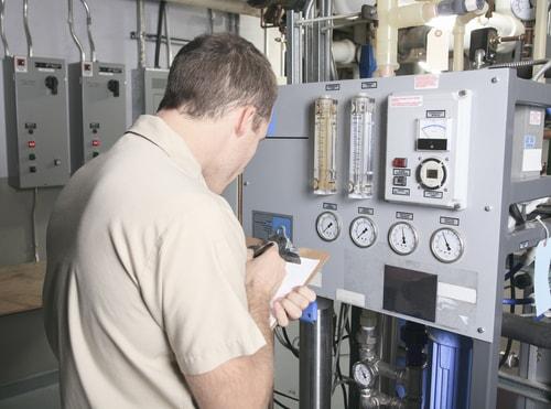 Commercial HVAC Repair - Commercial HVAC technician repairing HVAC system